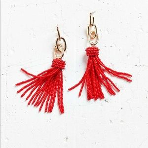 Urban Outfitters red tassel statement earrings